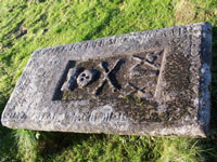 A tomb stone at church of St Columba's by Skeabost on Skye.
