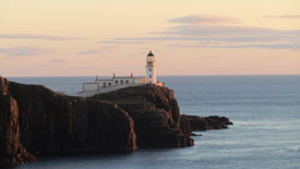 View as sun sets over Neist Point Light House.